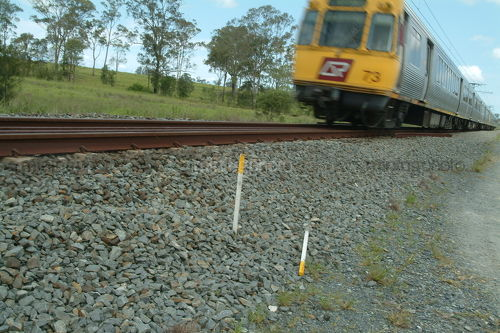 QLD Rail light passenger train moving in leafy area. shot at track level. - Mining Photo Stock Library