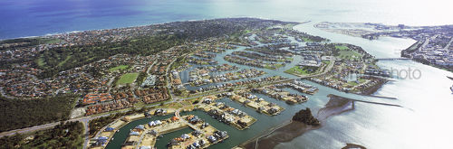 Aerial shot of residential subdivsion showing canals, marina, house lots, roads and bridges. - Mining Photo Stock Library