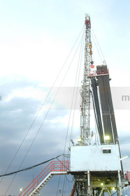 Drill rig in dawn light. - Mining Photo Stock Library