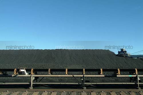 Coal reclaimer working at a coal stockpile. - Mining Photo Stock Library