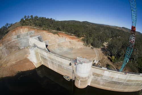 Construction of a dam. Aerial shot from crane bucket. - Mining Photo Stock Library