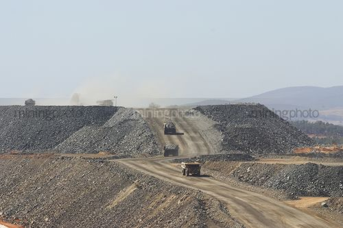 Haul trucks on haul road of open cut gold mine - Mining Photo Stock Library