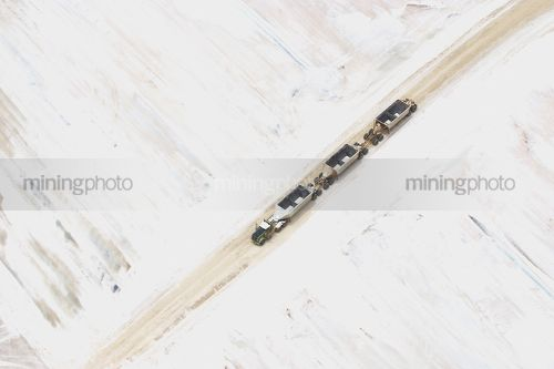 Salt haul truck with triple trailers at salt mine.  aerial shot. - Mining Photo Stock Library