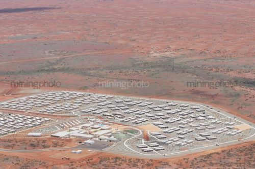 Aerial photo of 3000 person workers camp in iron ore country. - Mining Photo Stock Library