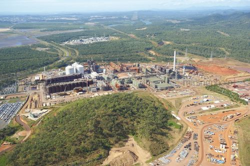 Aerial shot of bauxite and alumina refinery with township in background. - Mining Photo Stock Library