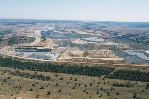 Great wide aerial shot of open cut coal mine.  cldarly see stockpiling of overburden, truck and digger rotation, dragline, rehabilitation and mine high walls. - Mining Photo Stock Library