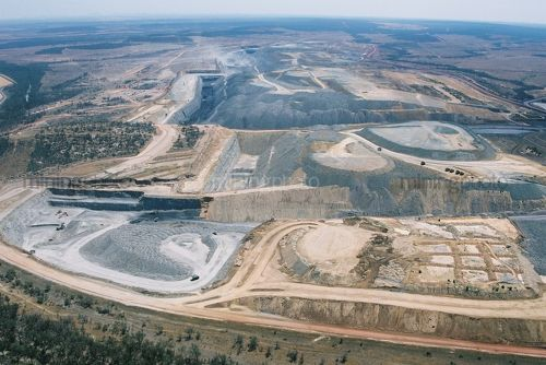 Wide aerial photo of working open cut coal mine in remote environment. - Mining Photo Stock Library