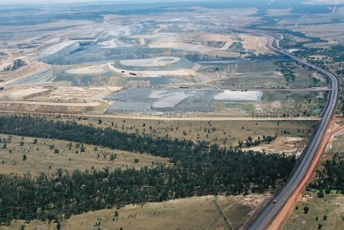 Long haul access road in open cut coal mine.  shot very wide and aerial. - Mining Photo Stock Library