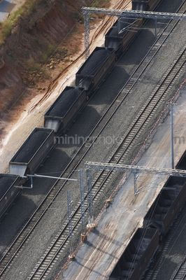 Aerial photo of heavy rail carriages cars carrying coal. - Mining Photo Stock Library