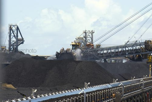 Coal reclaimers working stockpiles in coal terminal. - Mining Photo Stock Library