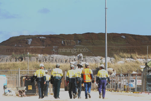 Group of mine workers in full PPE walking in shows teamwork.   - Mining Photo Stock Library