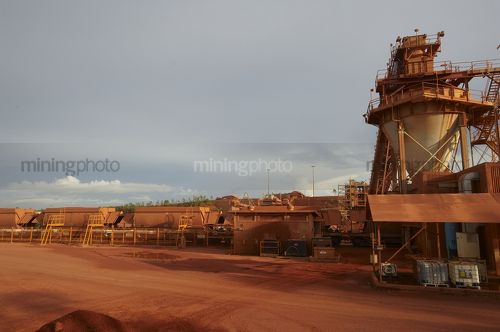 Rail carriages been loaded at  mine site. - Mining Photo Stock Library