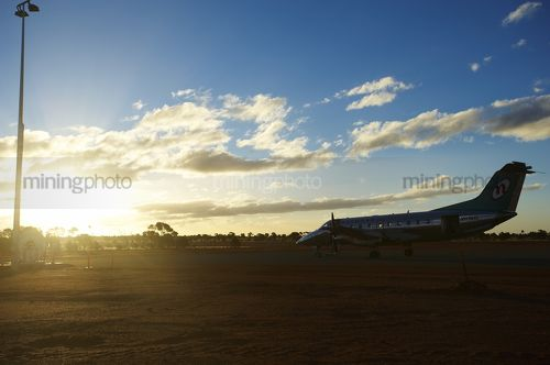 Crew change plane at mine site airstrip.  shot in the late afternoon. - Mining Photo Stock Library