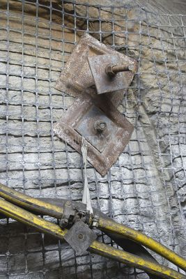 Close up photo of safety mesh in underground coal mine. - Mining Photo Stock Library