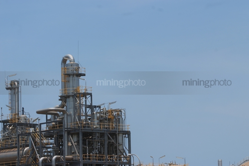 Close up of refinery pipework. great for background watermark.  room to insert person over the top. - Mining Photo Stock Library
