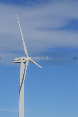Close up photo of large wind generator.  blue sky behind. - Mining Photo Stock Library