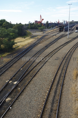 Rail tracks leading to coal stockpiler - Mining Photo Stock Library