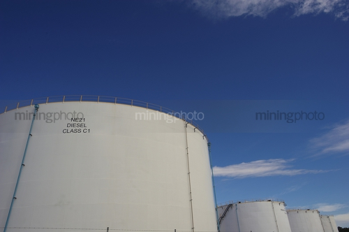 Large fuel storage towers. - Mining Photo Stock Library