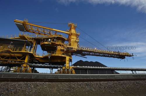 Up close photo of coal shiploader. - Mining Photo Stock Library
