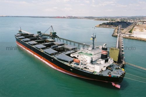 Ship being loaded with coal at terminal - Mining Photo Stock Library