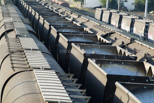 Heavy rail train carriages at coal port.   shot closeup. - Mining Photo Stock Library