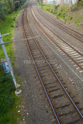 Three train tracks - light rail through cutting - Mining Photo Stock Library