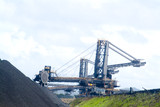 Mining Photo Stock Library - coal reclaimer and loader working stockpiled coal at ship terminal ( Weight: 1  New Image: NO)