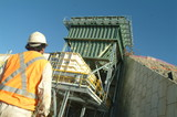 Mining Photo Stock Library - worker in ppe looking up at coal hopper shot from behind ( Weight: 1  New Image: NO)