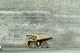 Mining Photo Stock Library - loaded haul truck moving with opencut high walls behind ( Weight: 1  New Image: NO)