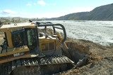 Mining Photo Stock Library - swamp bulldozer pushing dirt to cover coal tailings dam ( Weight: 4  New Image: NO)