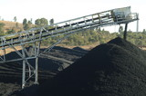 Mining Photo Stock Library - conveyor stockpiling coal with power station smokestack in distance  ( Weight: 2  New Image: NO)
