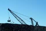 Mining Photo Stock Library - Silhouette of drag line excavator behind stockpiled coal ( Weight: 1  New Image: NO)