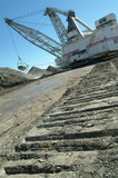 Mining Photo Stock Library - caterpillar tracks of dragline leading up to working machine shot vertical ( Weight: 1  New Image: NO)