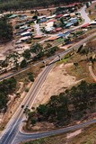 Mining Photo Stock Library - cars on a 2 lane highway with railway bridge and residential subdivision in background. aerial shot ( Weight: 1  New Image: NO)