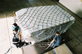 Mining Photo Stock Library - workers adding cargo net to agriculture airline freight ( Weight: 5  New Image: NO)