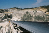 Mining Photo Stock Library - foreman walking back down stockpile conveyor with open cut mine and haul truck in background ( Weight: 1  New Image: NO)