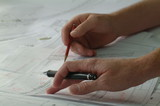 Mining Photo Stock Library - closeup of hands with pen and pencil above engineering plans. good generic shot ( Weight: 2  New Image: NO)