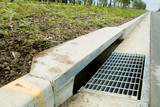 Mining Photo Stock Library - storm water drain and curbing on road at a recently completed subdivision.  shot from road level ( Weight: 1  New Image: NO)