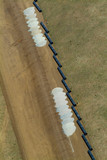 Mining Photo Stock Library - vertical aerial of domestic water supply pipes and sand ready for crane to assemble ( Weight: 2  New Image: NO)