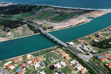 Mining Photo Stock Library - aerial of highway bridge over river near ocean property subdivision  ( Weight: 1  New Image: NO)