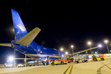 Mining Photo Stock Library - conveyors loading a large cargo plane at night at airport ( Weight: 1  New Image: NO)