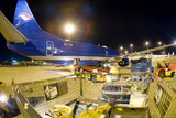 Mining Photo Stock Library - freight being loaded onto cargo plane at airport. shot at night. ( Weight: 3  New Image: NO)