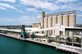 Mining Photo Stock Library - tall storage silos on ship wharf.  aerial image. ( Weight: 2  New Image: NO)