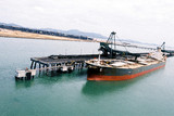 Mining Photo Stock Library - ship loaders loading coal by conveyor into hold of ship. aerial image shot from sea looking to land. ( Weight: 1  New Image: NO)