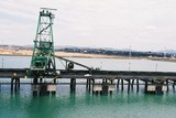 Mining Photo Stock Library - coal shiploader on wharf with coal stockpile in background ( Weight: 3  New Image: NO)