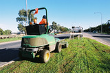 Mining Photo Stock Library - maintenance worker in PPE on small tractor mowing centre grasas strip on residential highway road. ( Weight: 1  New Image: NO)