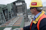 Mining Photo Stock Library - supervisor in ppe overseeing powerstation ( Weight: 1  New Image: NO)