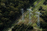 Mining Photo Stock Library - aerial looking down at 3 parallel transformer electricity towers in forest ( Weight: 1  New Image: NO)