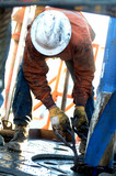 Mining Photo Stock Library - worker on drill rig floor working at the derrick ( Weight: 1  New Image: NO)