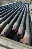 Mining Photo Stock Library - pipe casings laid out ready to install down drill rig oil gas hole ( Weight: 3  New Image: NO)